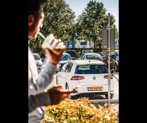 Woman charging a car
